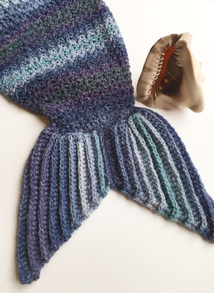 A personal favourite from my Etsy shop https://www.etsy.com/uk/listing/472875551/childs-handmade-crochet-mermaid-tail