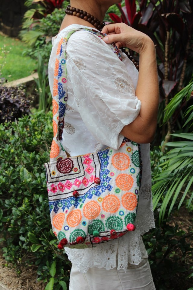 Each Raja hand bag is individually made of unique fabrics. Each bag is one of a kind in terms of the fabric used.  To purchase go to : www.laloom-kaftans.com.au