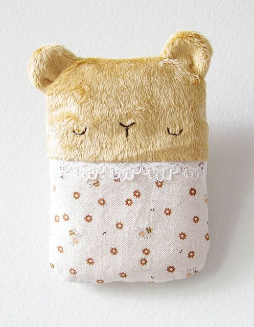 Sleeping bear.  This would be easy to make.  And sooo adorable for a baby :)
