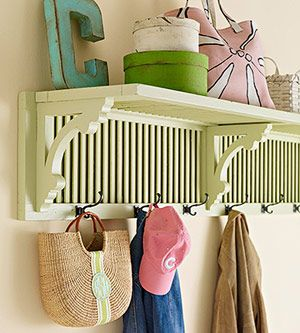 Create an entryway shelf plus coat rack by repurposing a pair of old shutters and wooden brackets. If you don't have extra brackets sitting around your home, you can find them at an architectural salvage shop. Simply sand, prime, and paint the shutters and brackets, then attach them with screws while they're positioned at a 90-degree angle. Attach coat hooks along the bottom.