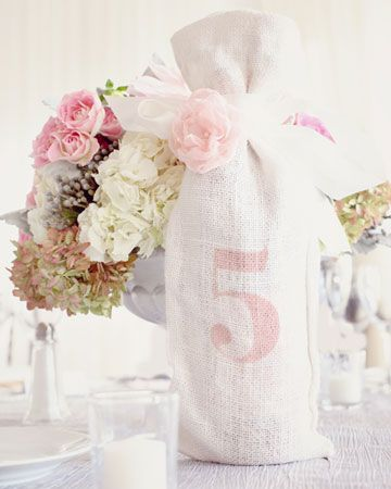 Table number: Wine bottles wrapped in burlap #pink #wedding #ido #inspiration