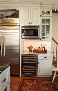 There was a desk area but the homeowner wanted to remove it. The designer was able to use that wall for more appliances including a large refrigerator, microwave and an awesome wine chiller with Dura Supreme Cabinetry. Designed by Karr Bick Kitchen and Bath.