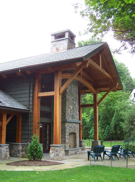 A two story timber porch allows open views from within the home to the  adjacent fairwayBest 25  Outdoor stone fireplaces ideas on Pinterest   Outdoor  . Large Outdoor Fireplace. Home Design Ideas
