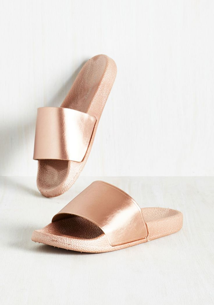 Brimming with optimism, you realize that your metallic sandals are inspiring your outlook. There's just something about the transformative rose gold sheen this slide-silhouette pair boasts that makes you smile, and as everyone else is looking down at your shoes, you're looking up from the all positivity!