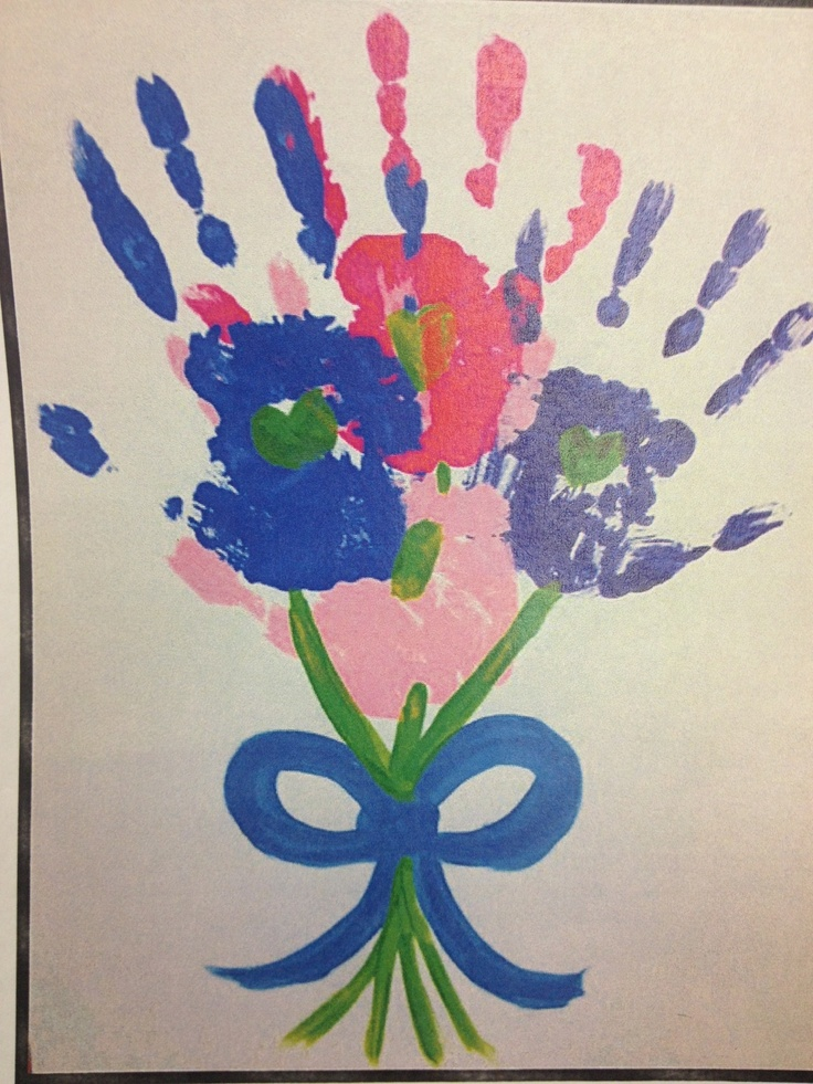 1st meeting craft with all the girls' handprints together