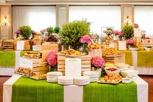 For silent auction: use various wooden boxes for varying height, lemon, lime, orange & brown on white for tables.