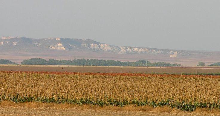 Castle Rock Badlands in distance across fields