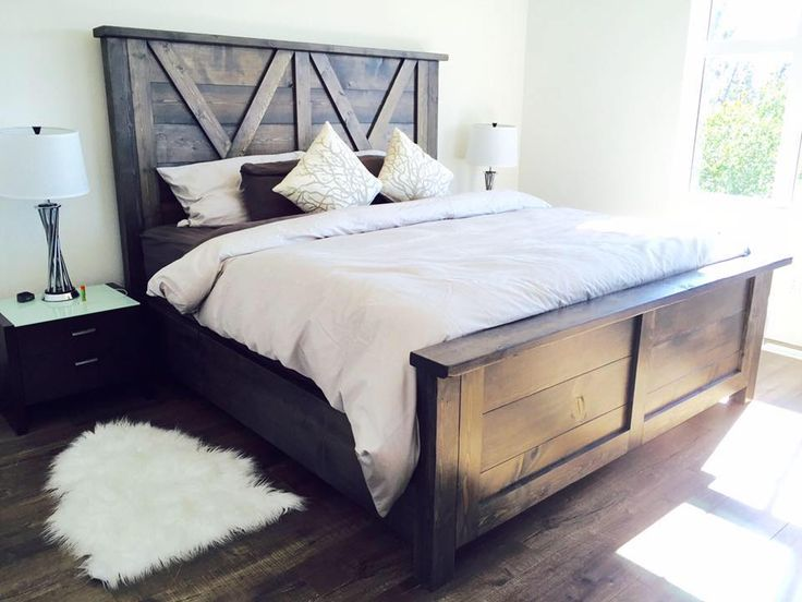 beautiful barn door style farmhouse bed