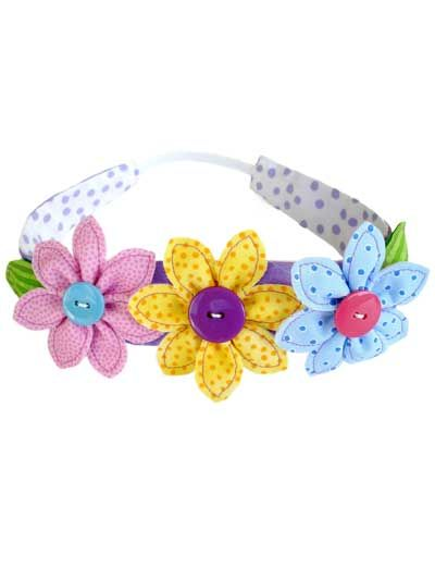 "The flower patterns may be reduced or enlarged to make them different sizes. Sample headbands and flowers are made from cotton fabrics for every day. Use silk, satin or taffeta for special occasions! Acrylic or wool felt may be used to back flowers. Felt is fused to the wrong side of the fabric. Then the shapes are cut out and stitched around the edges. Size: To fit 1 1/2""-wide purchased headband for girls and women."