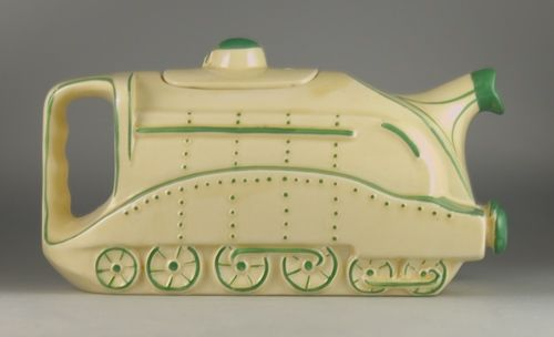 A genuine rare and classic 1930's Staffordshire teapot formed in the shape of a locomotive and decorated with green trim