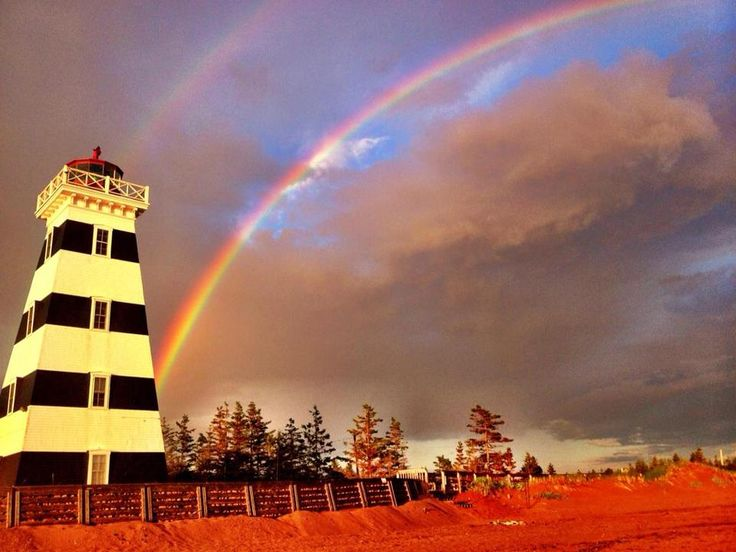 An incredible shot of last week's double rainbow over the iconic West Point Lighthouse in #PEI. #ExploreCanada