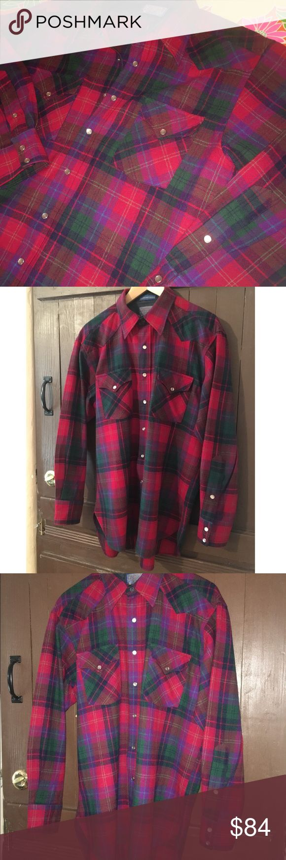 "NWOT Pendleton Western 100% Virgin Wool Shirt Absolute showstopper. Superior quality authentic Pendleton Woolen Mills 100% Virgin Wool Western Dress Shirt with classic pearl snap buttons, lined cuffs and collar. Red with green, purple and teal plaid print. MADE IN USA! Brand new with no damage, stains, odor etc. Lasts forever! Tiny size tag fell off. Magnificent piece of Americana. Ships fast from a clean, conscious, smoke-free home. Measurements: Chest: 48"" Shoulders: 20"" Sleeves: 23""…"