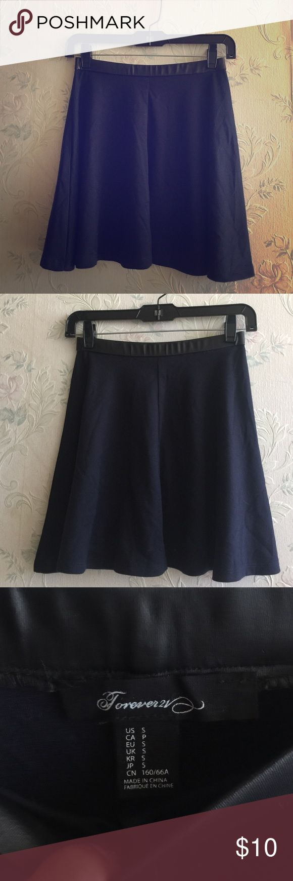Navy blue skater skirt Navy blue skater skirt with leather detailing. Worn once still looks brand new Forever 21 Skirts Mini