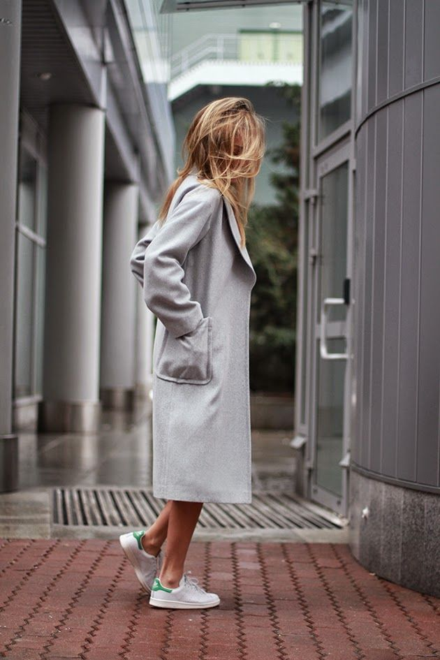 Street Style: Magdalena Knitter is wearing a grey three quarter length coat from Zaquad, and the Stan Smith sneakers are from Adidas