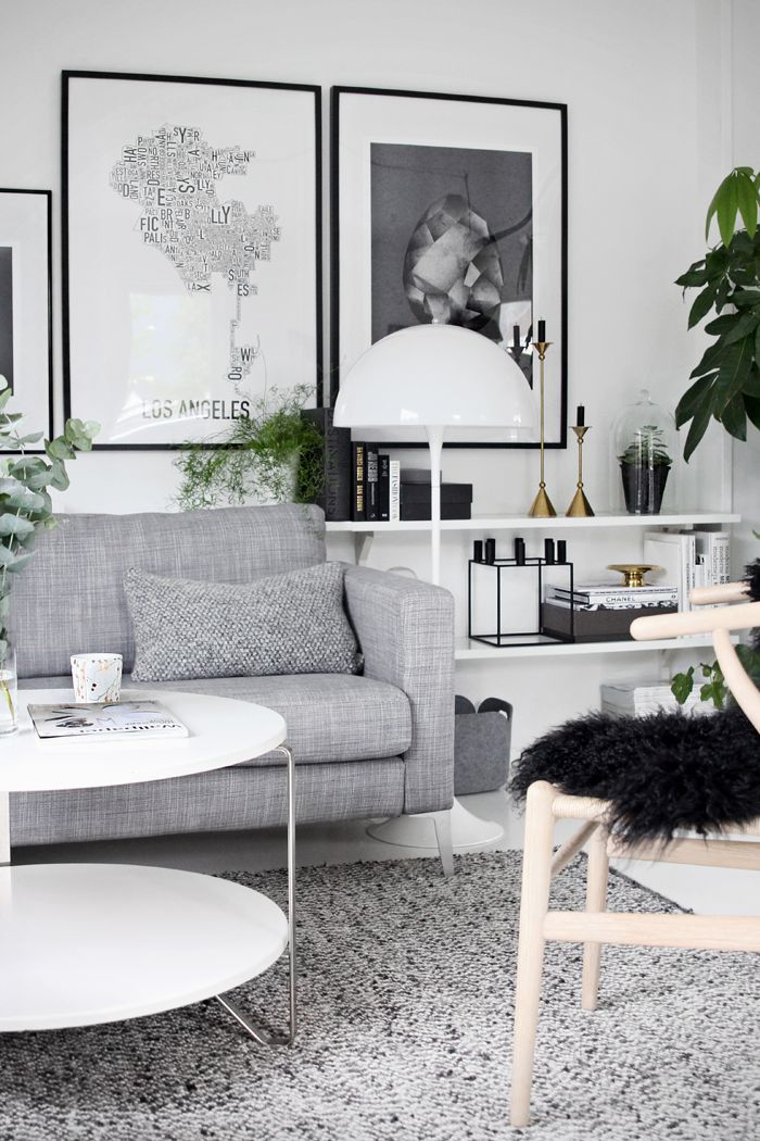 Great big prints <3. Love that the shelves go behind the couch. Usually not a fan of grey but the different shades and textures are so well coordinated here.