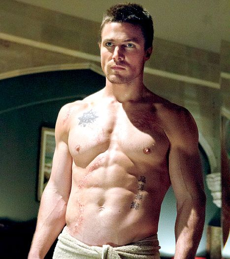 Stephen Amell from the New CW Arrow show.... I wouldn't kick him outta bed. LOL ;) Christian Grey?