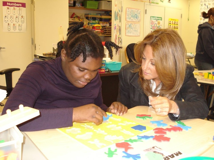 """Week 1 Winner for the CCE """"Service Sightings"""" Photo Competition!  """"I volunteered for SCO Family of Services nonprofit organization. Here is a picture of a woman working with a child who is a resident of their St. Christopher's Home, a residential treatment center that serves children and adolescents with developmental disabilities."""" -- Emily Ferrara, senior, math major."""