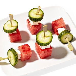Cool Skewers -- Red, white, and green kabobs: Skewer 1 cube watermelon, 1 small cube feta, and 1 slice cucumber on each of five toothpicks.