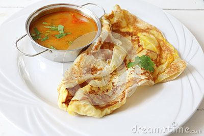 Malaysian Indian Pakistani cuisine Roti telur served with curry sauce