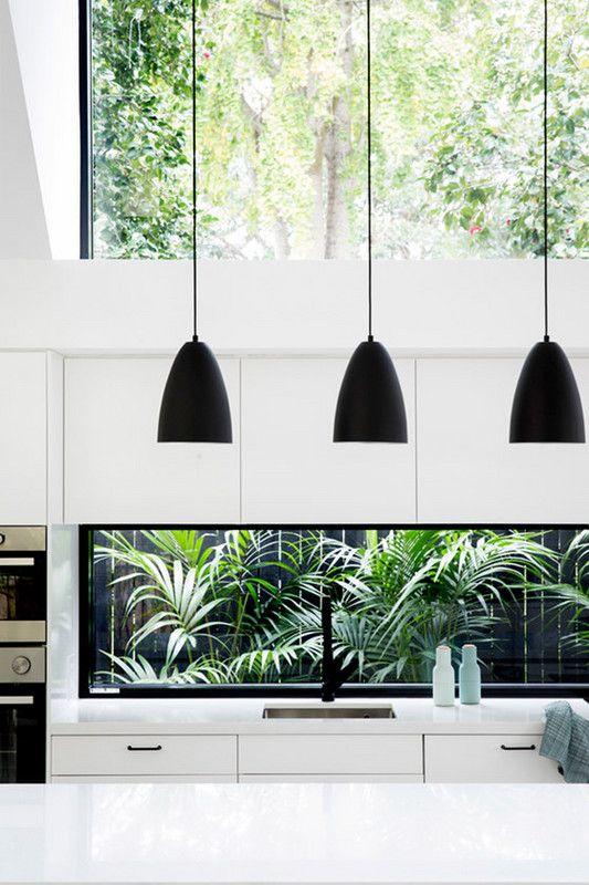 white kitchen, bold black accents