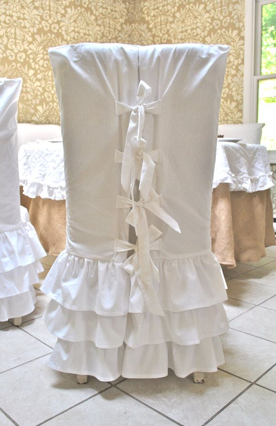 White Ruffle Chair Slipcovers ((too many ruffles for me but the ties are GORGEOUS!
