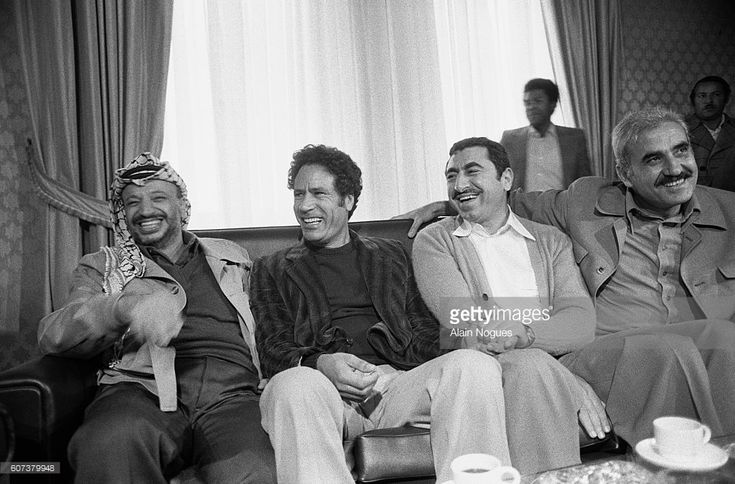 Arab political leaders from Libya, Algeria, Syria, South Yemen and the Palestine Liberation Organization gather in Tripoli during a summit for the creation of the 'Firmness Front'. Attending from left: Yasser Arafat of the Palestine Liberation Organization, Muammar Qaddafi of Libya, Nayef Hawatmeh of the Democratic Front for the Liberation of Palestine and Georges Habache of the Peoples Front for the Liberation of Palestine.