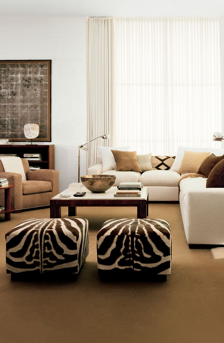 The concrete jungle: Bring a touch of safari to an otherwise modern apartment with wild animal print fabrics