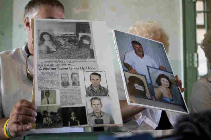 dave wildner holds up articles on his uncles john and clarence anglin, supposedly drawned during escape but did they?