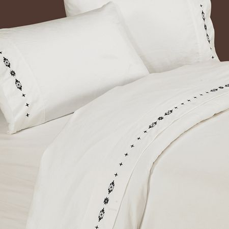 350 TC Cotton Sateen White Embroidered Navajo Sheets avajo sheets in soft 350 thread count 100% cotton white sateen embroidered with a unique Navajo pattern on the hem of the flat sheet and pillow cases are the perfect way to finish off your #southwestern #bedroom #decor. #BeddingNMore