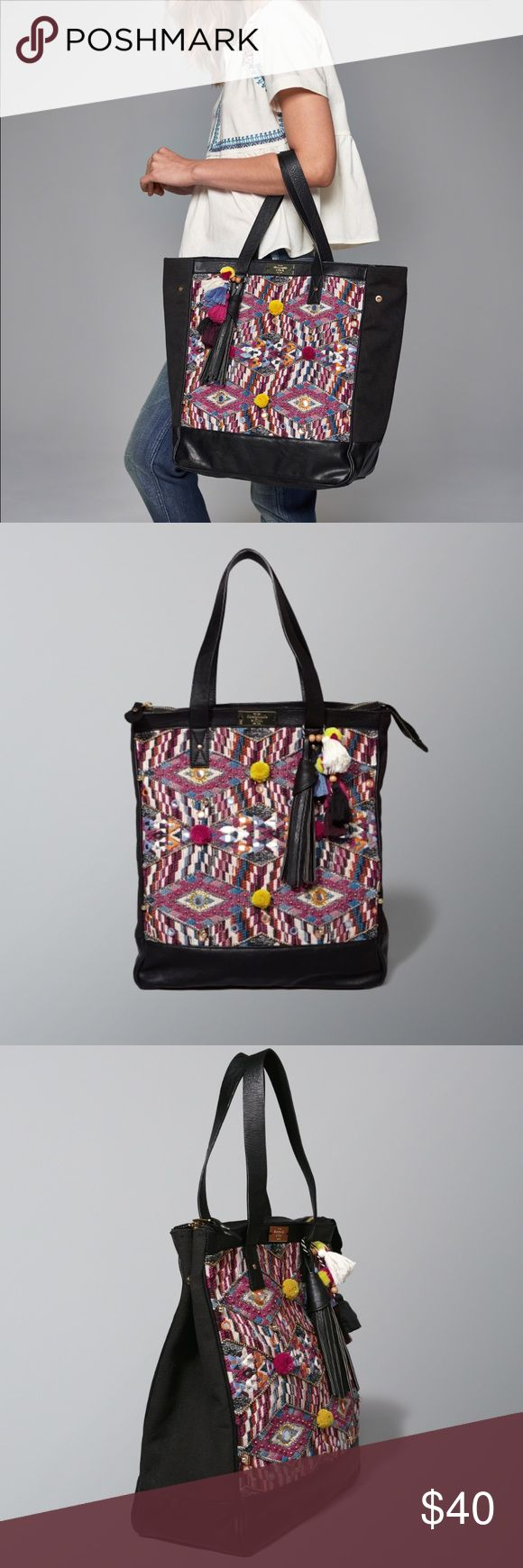 Woven Geometric Tote Bag Abercrombie and Fitch black woven tote bag with faux leather details. Colorful geometric woven design with pom poms, tiny gold balls and fringe charms add boho chic detail. ✨NWOT!✨ Abercrombie & Fitch Bags Totes
