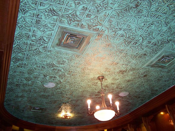 Turquoise ceiling tiles. Would make an awesome back splash.