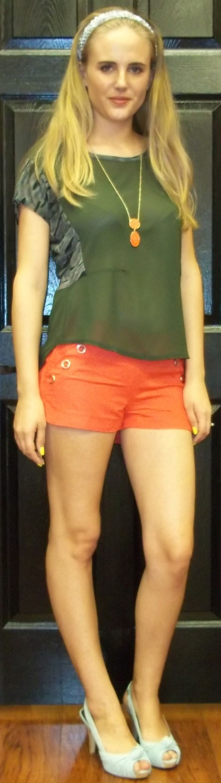 Army Green T with Camo Detailing, Coral Shorts and a Coral Pendant Necklace. Sequin Scarf Used as a Headband ~ Apricot Lane Boutique South Florida