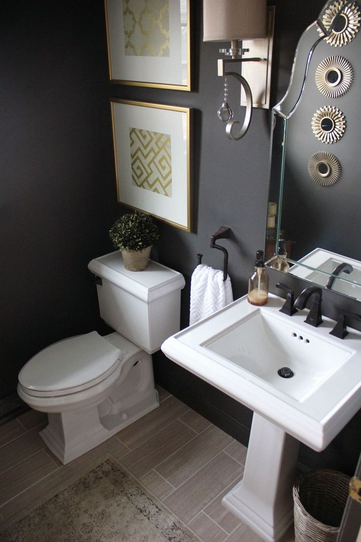 Lee Owens Design | Elegant Contemporary Home // bold color, patterns, powder room, black walls, Sherwin Williams Urbane Bronze, gold, brass accessories, bathroom