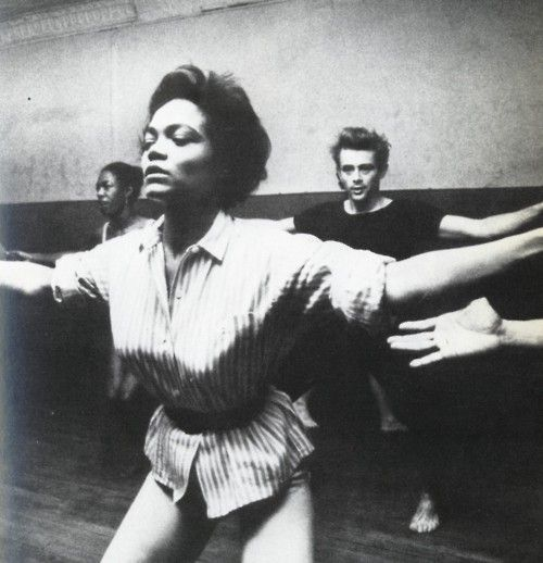 Eartha Kitt teaching a dance class with James Dean in the background.