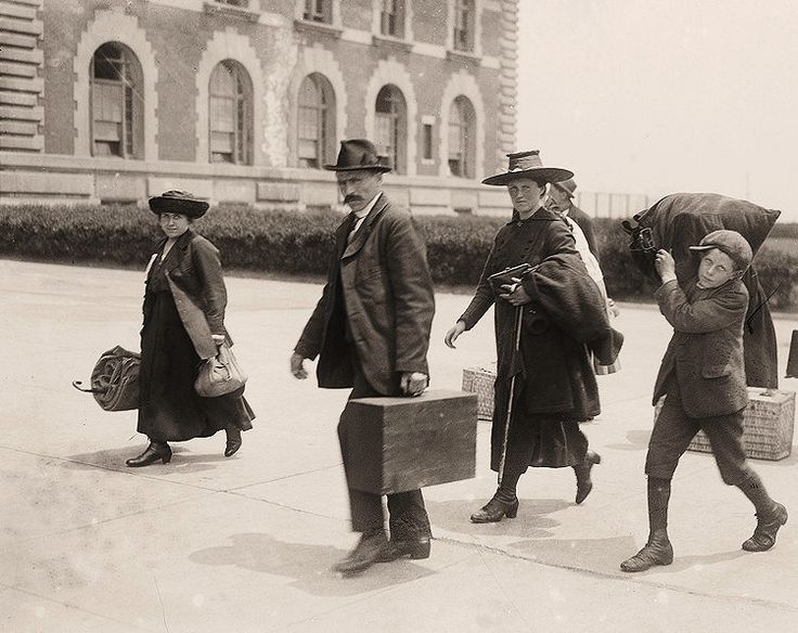 U.S A family arrives at Ellis Island to begin new lives in America. c1910