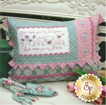 """The Rivendale Collection - Daughter: This charming pattern is a part of The Rivendale Collection by Sally Giblin. Pattern includes instructions for stitchery, instructions for appliqu�, and instructions for cushion. Finished size is 15"""" x 22"""".The hand embroidered verse says, """"God made you my daughter...Love made you my friend."""""""
