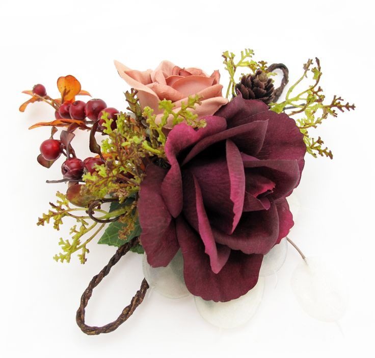 A purple open fresh touch rose, dusk classic rose and a mix of woodsy berries and foliage make a unique wristlet. Find your perfect wedding flowers at http://www.loveflowers.com.au