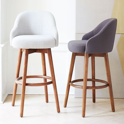 A shapely swivel seat. Inspired by mid-century design, our Saddle Bar + Counter Stool's modern form and clean aesthetic bring a casual elegance to kitchen islands. Perched on pecan-stained solid wood legs, its swiveling seat comes covered in your choice of two upholstery options.