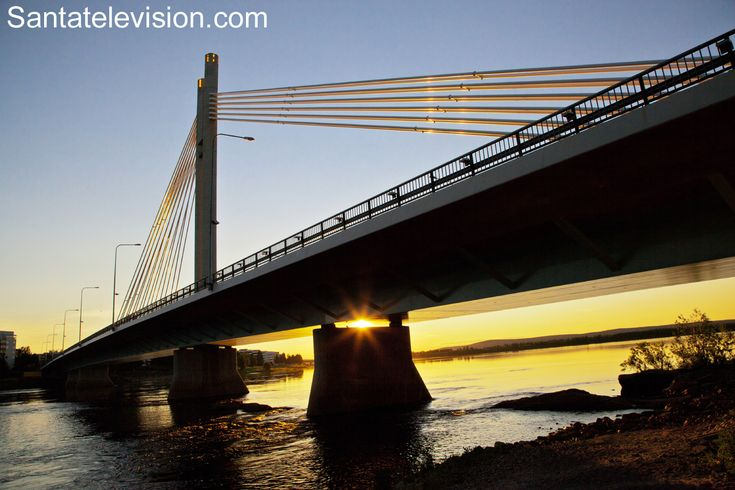 Sunset under the Lumberjack Candle Bridge in Rovaniemi city center in Lapland