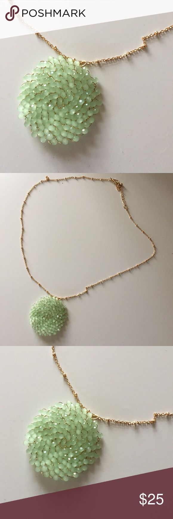 NYC Boutique Long Gold Chain with Pendant NWOT Dainty Gold chain(not real gold) with round pendant bought at a Boutique in NYC. Never worn. Pendant is delicate with light green beads. Jewelry Necklaces