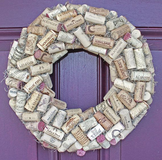 Used, mixed wine corks on straw base can be used as a wreath, ready to hang, or as a table centerpiece with candle (not included), or a bottle of wine. Measures 14 inches diameter.