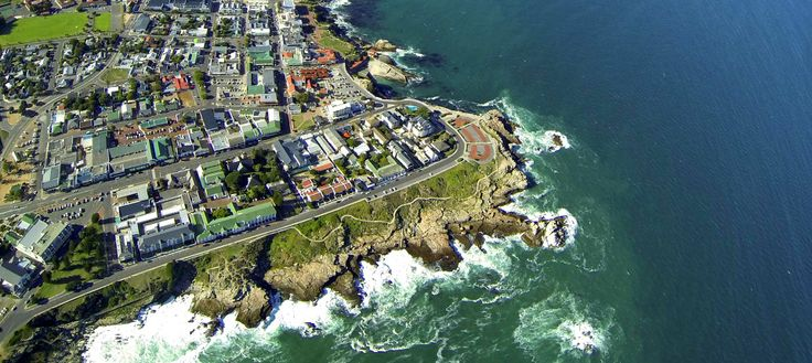 The Windsor Hotel is in the center of Hermanus and is one of the oldest Hotels in the town. The photo is a great aerial view of Gearings Point. A rocky promontory that is a popular place in town to enjoy an Ice cream ad watch the sun set and also a great place to see Southern Right Whales during the Whale season.
