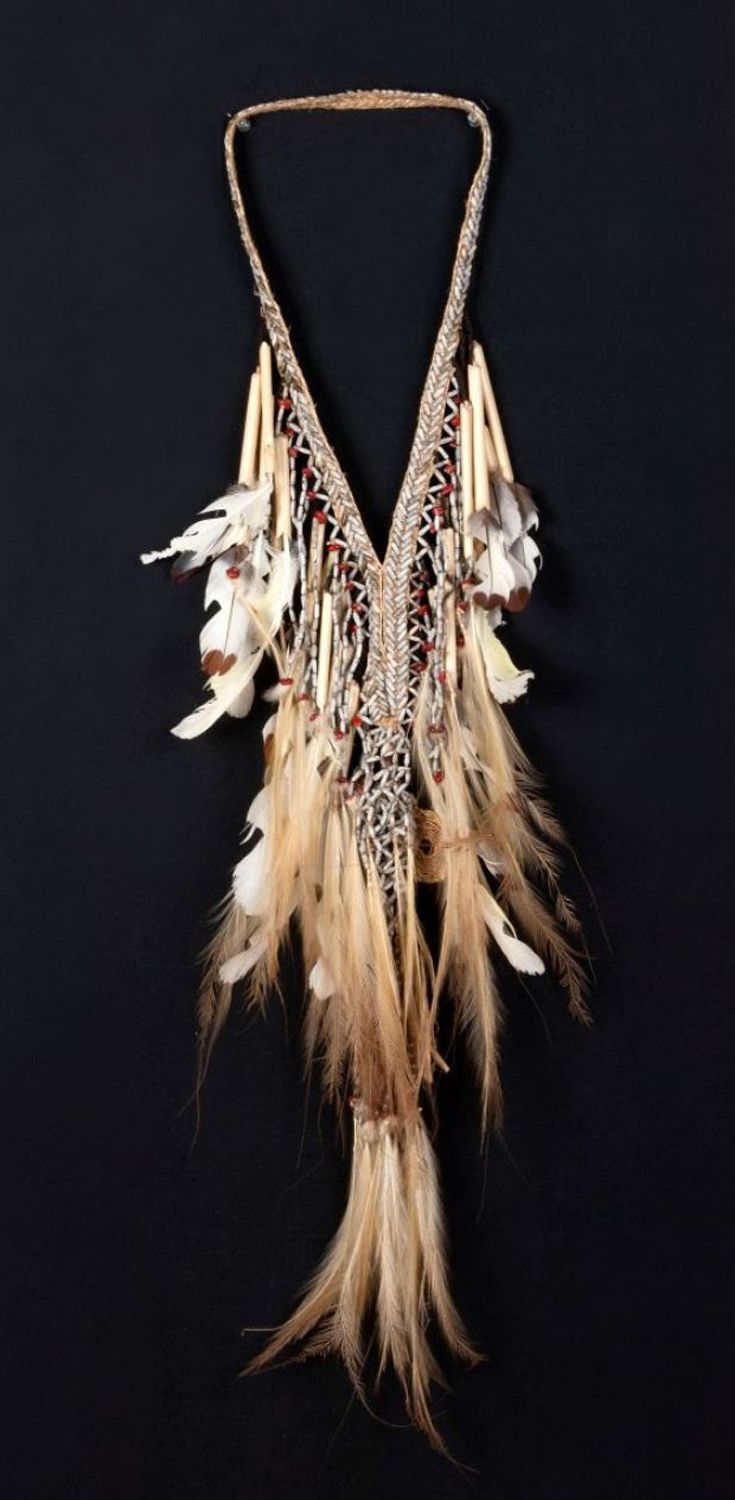 Papua (Indonesia) ~ Auyu, Digul River region, Merauke regency | Decoration for a successful headhunter ~ 'Tok' | Natural fiber, cane rods, grey and red seeds, feathers | ca. 1956 or earlier
