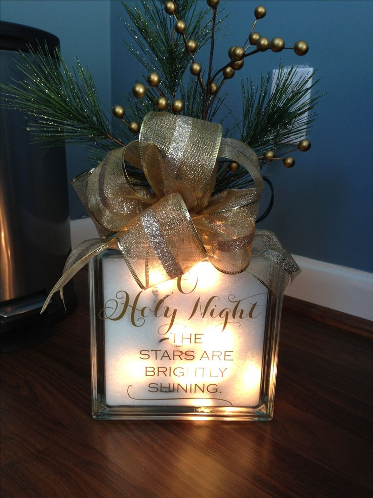 Christmas decor. Glass block with lights, Christmas decal and floral detail.