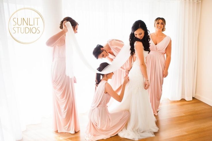 All the bridesmaids doing a wonderful job! Photography by Gold Coast photographers, Sunlit Studios.