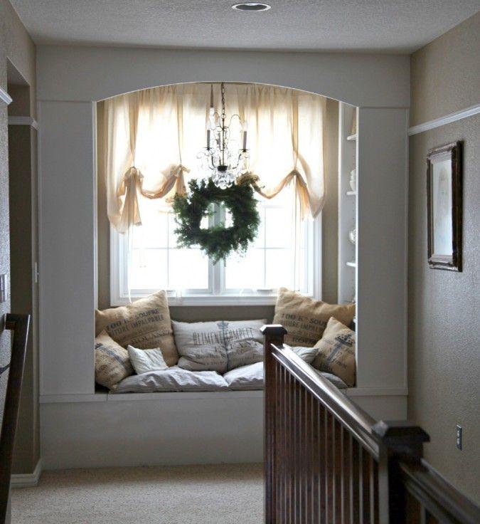 cozy window seat... love the wreath, too!