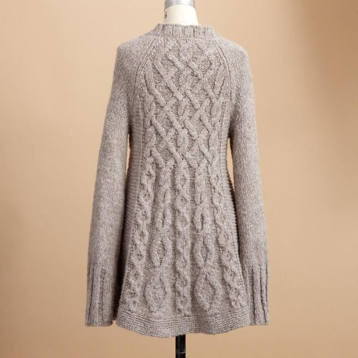 Plump cables join to echo the v-neck of this cozy cardigan, further detailed with garter stitch panels and brushed metal buttons. Hand wash. Imported....