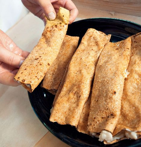 """""""Sultsina"""" is a traditional dish in Karelia. It's made of rye flatbread filled with pearl barley (mannaryyni), rice porridge or cracked barley (ohraryyni)."""