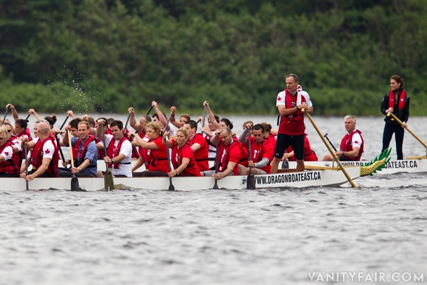 And they're off! Prince William looks a bit overdressed for dragon-boat racing, while Princess Catherine (far right) stands at the ready.