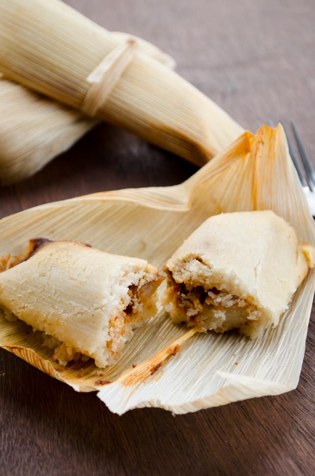 Vegan potato adobo tamales. They are filled with a mixture of potatoes and peas tossed in a spicy adobo sauce. The adobo is smoky, spicy, tangy, and has an earthy quality to it. The masa that surrounds it, is fluffy and light